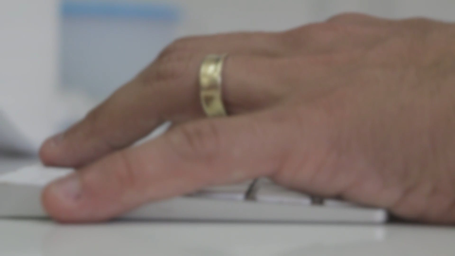 Close Up Of Hand With Gold Ring