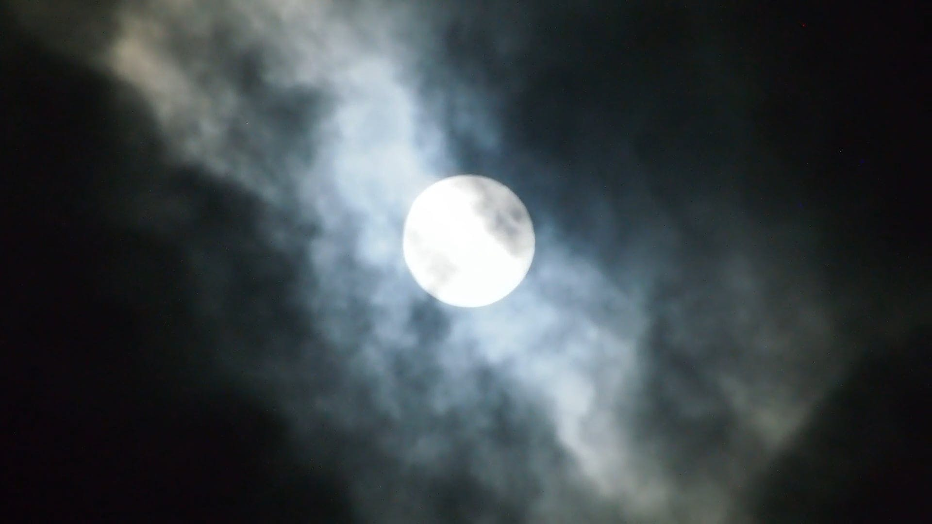 Full Moon Slowly Being Covered by Clouds