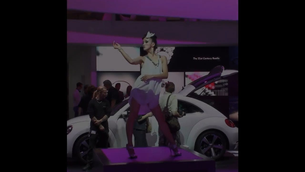 Woman Dancing During Car Show