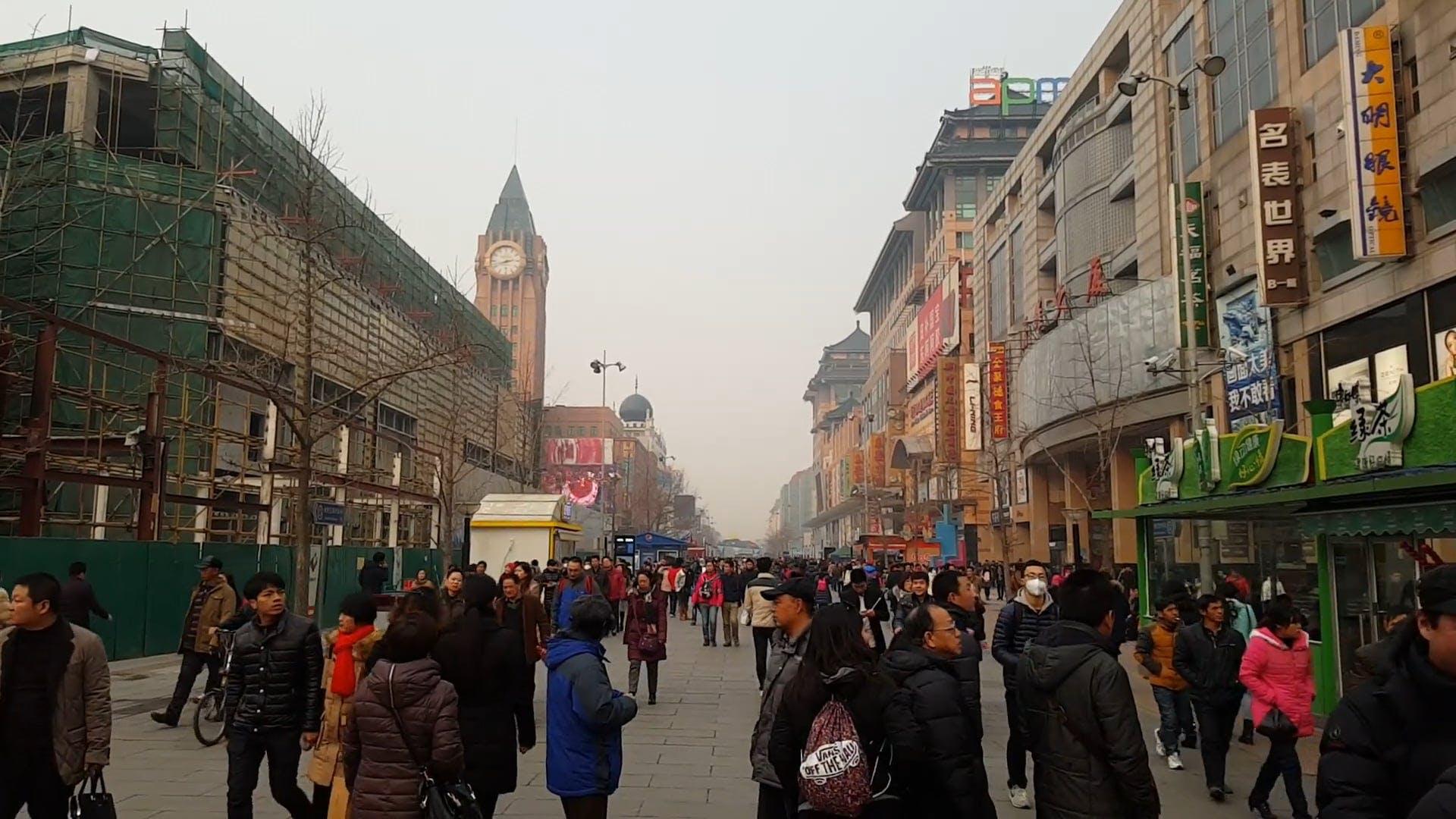 People Walking Busy Streets in Winter