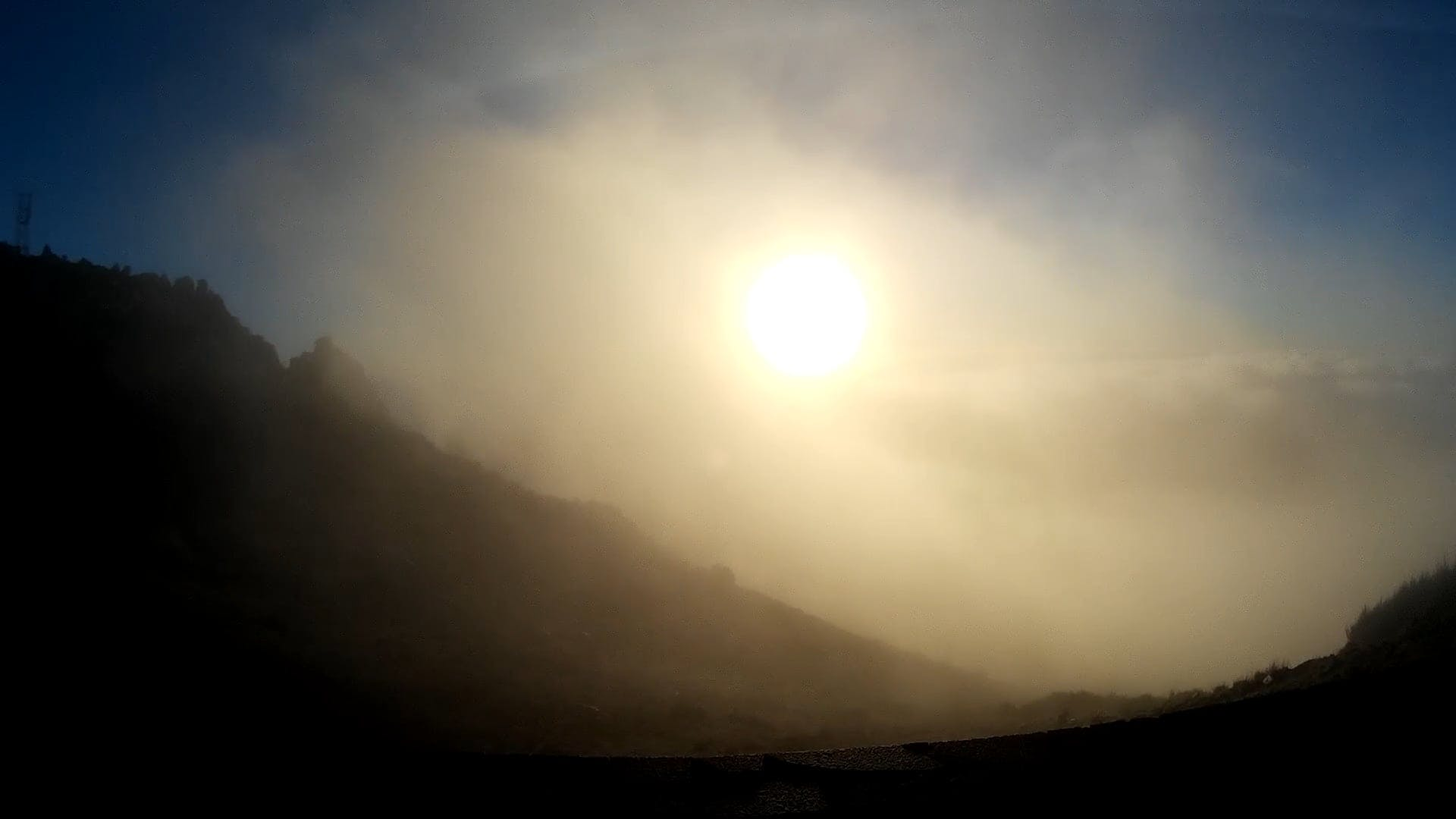 Early Morning Sunrise And Thick Fog