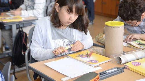 Female Student Using a Math Compass
