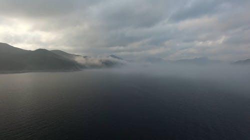 Aerial Shot Of foggy Ocean