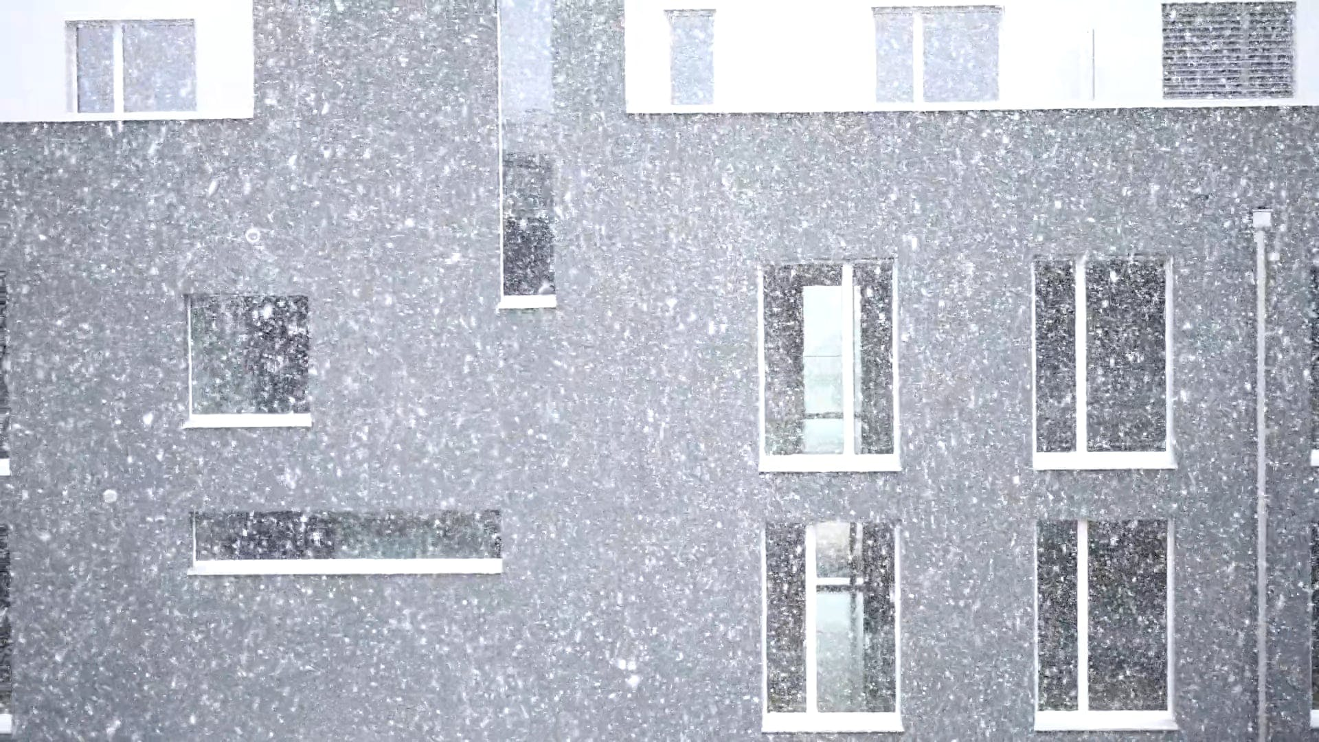 Snowfall In Front Of A Building