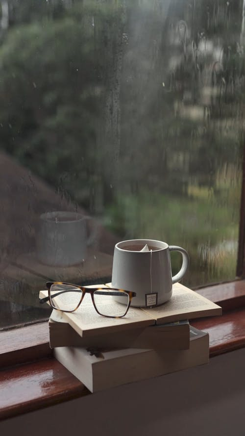 Hot Tea and Reading Glasses while Raining