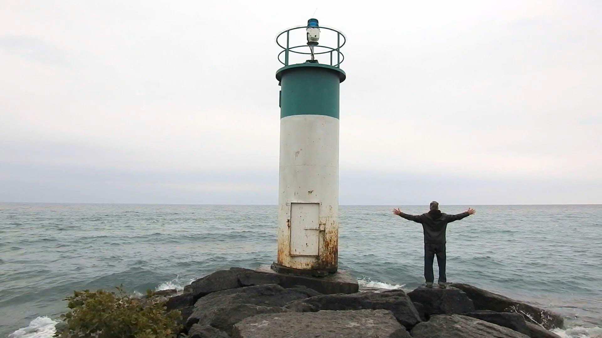 Man Enjoying The Waves Crashing