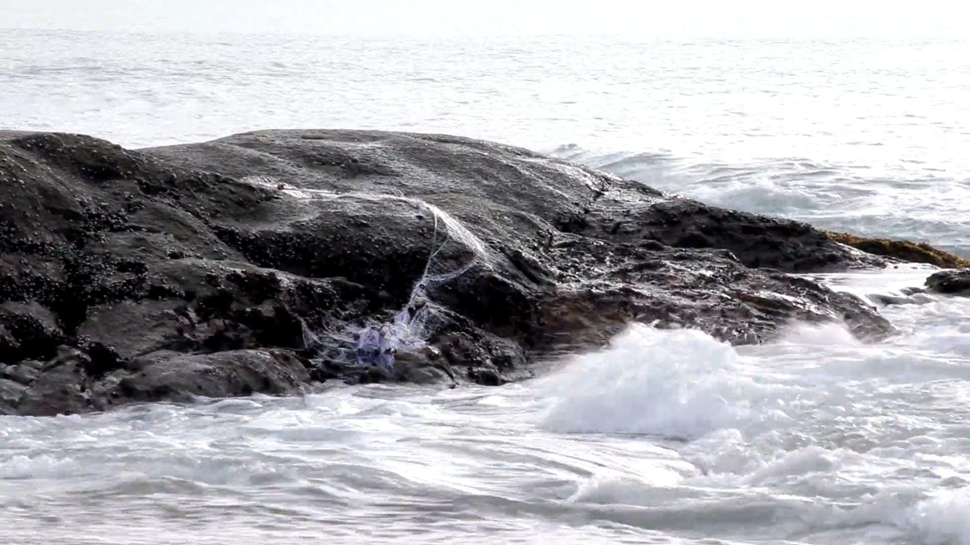 Waves Crashing On A Rock