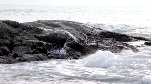 Waves Crashing On A Rock