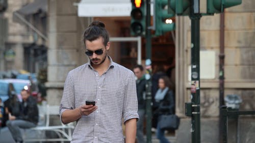 Man Texting On The Street