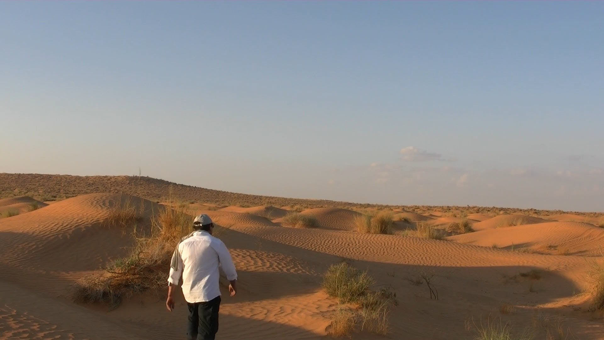 Man Standing In The Middle Of Desert