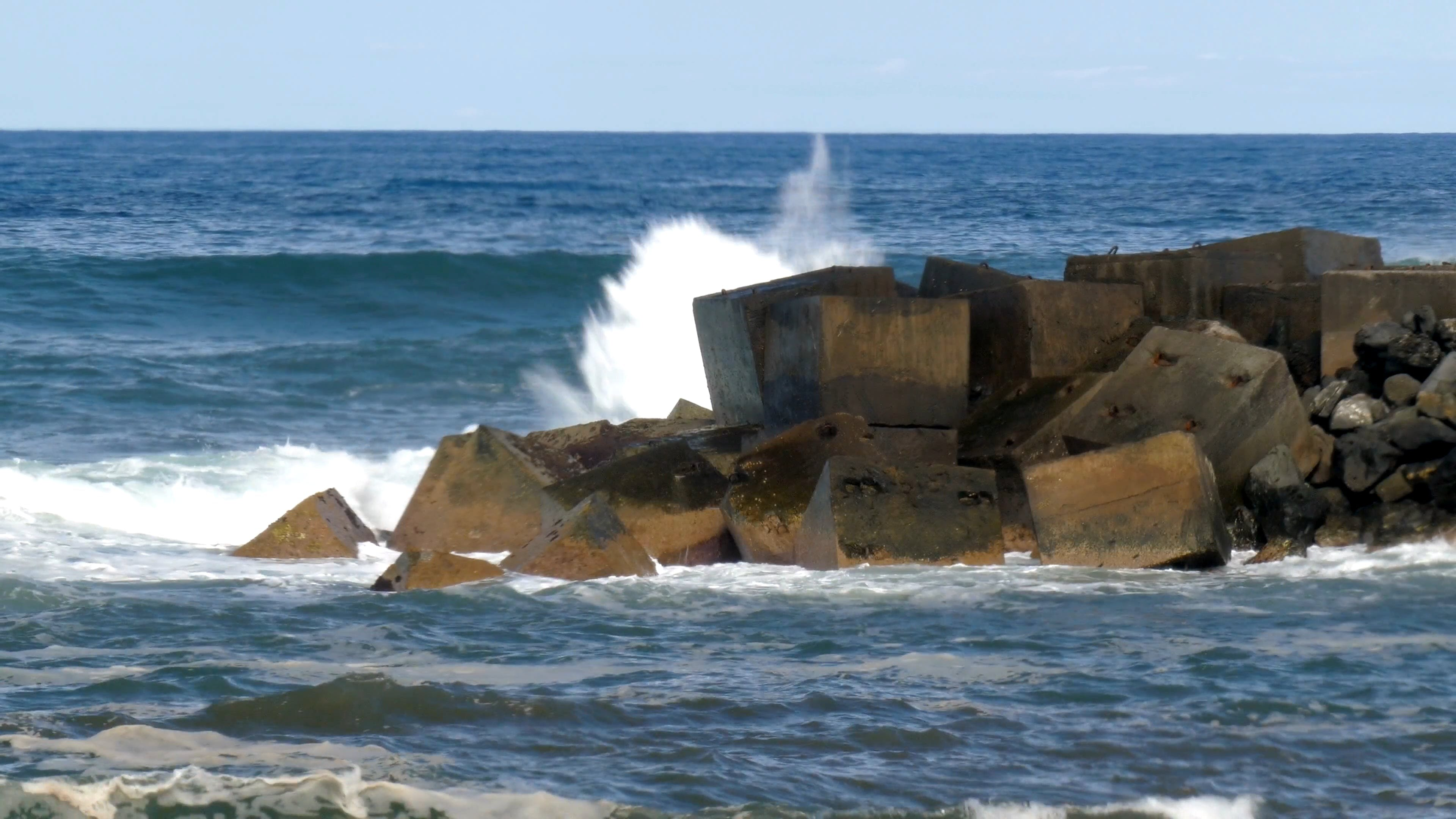 Waves Crashing Through Big Rocks