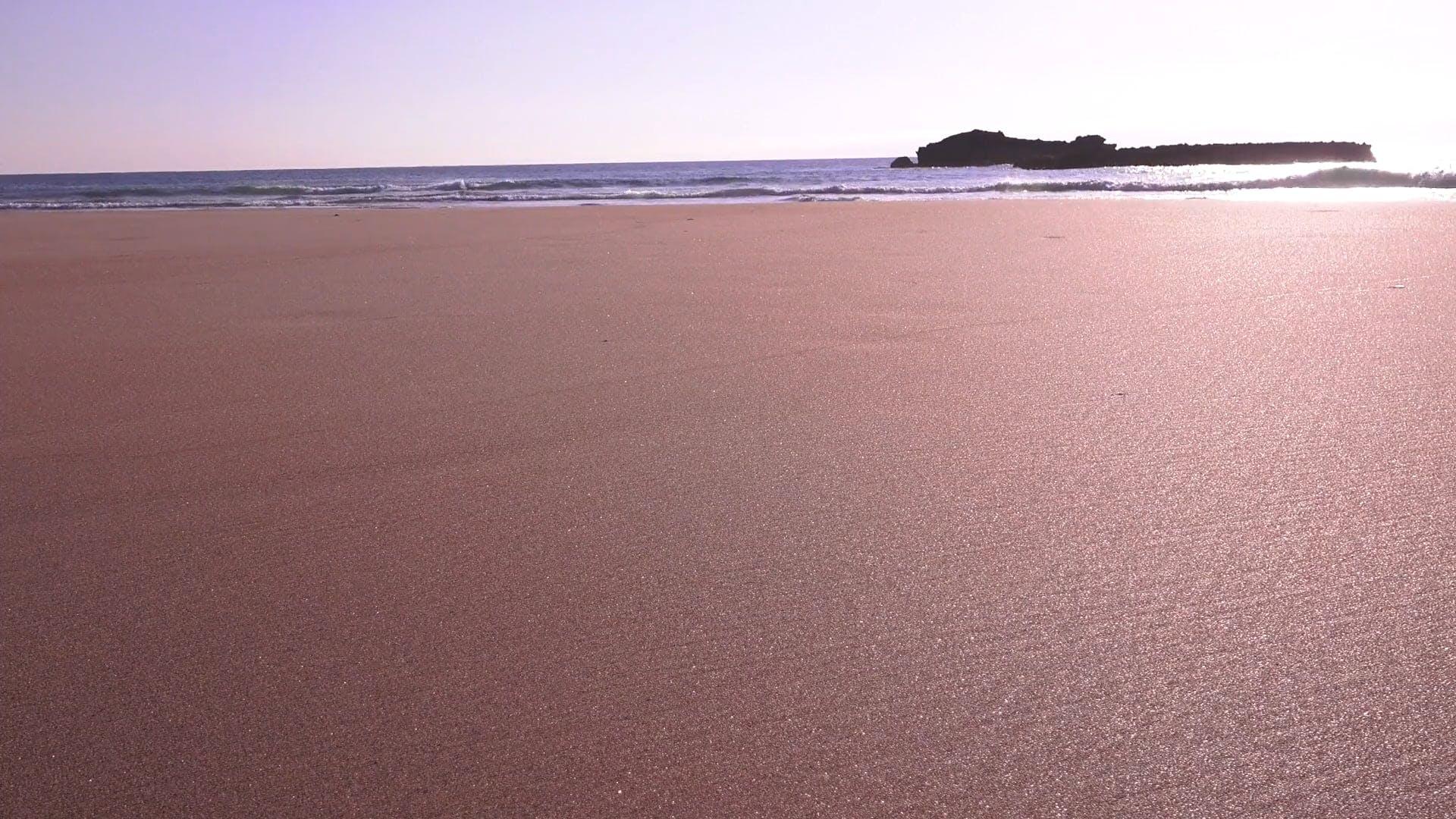 Beach Sand And Waves