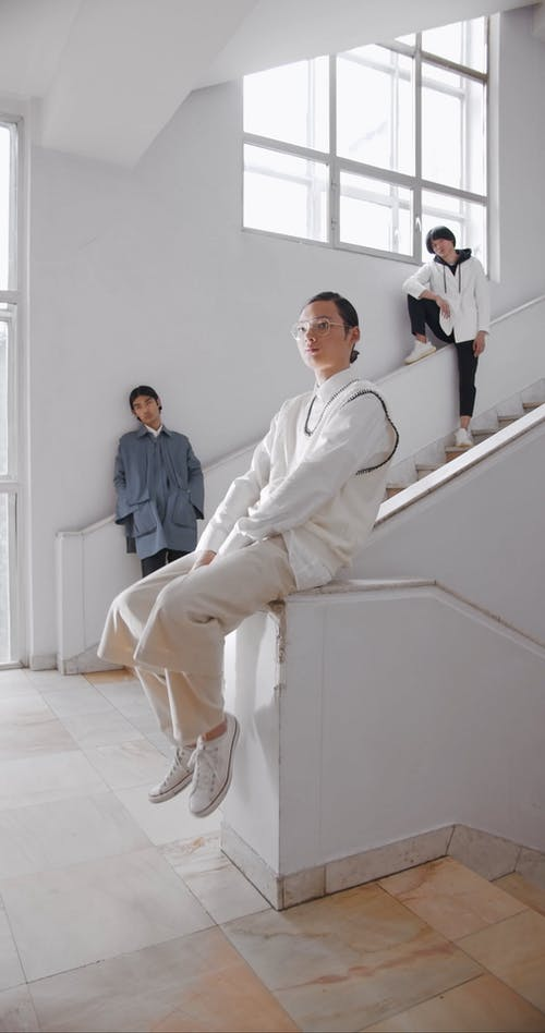 Men Posing at the Camera while in the Staircase