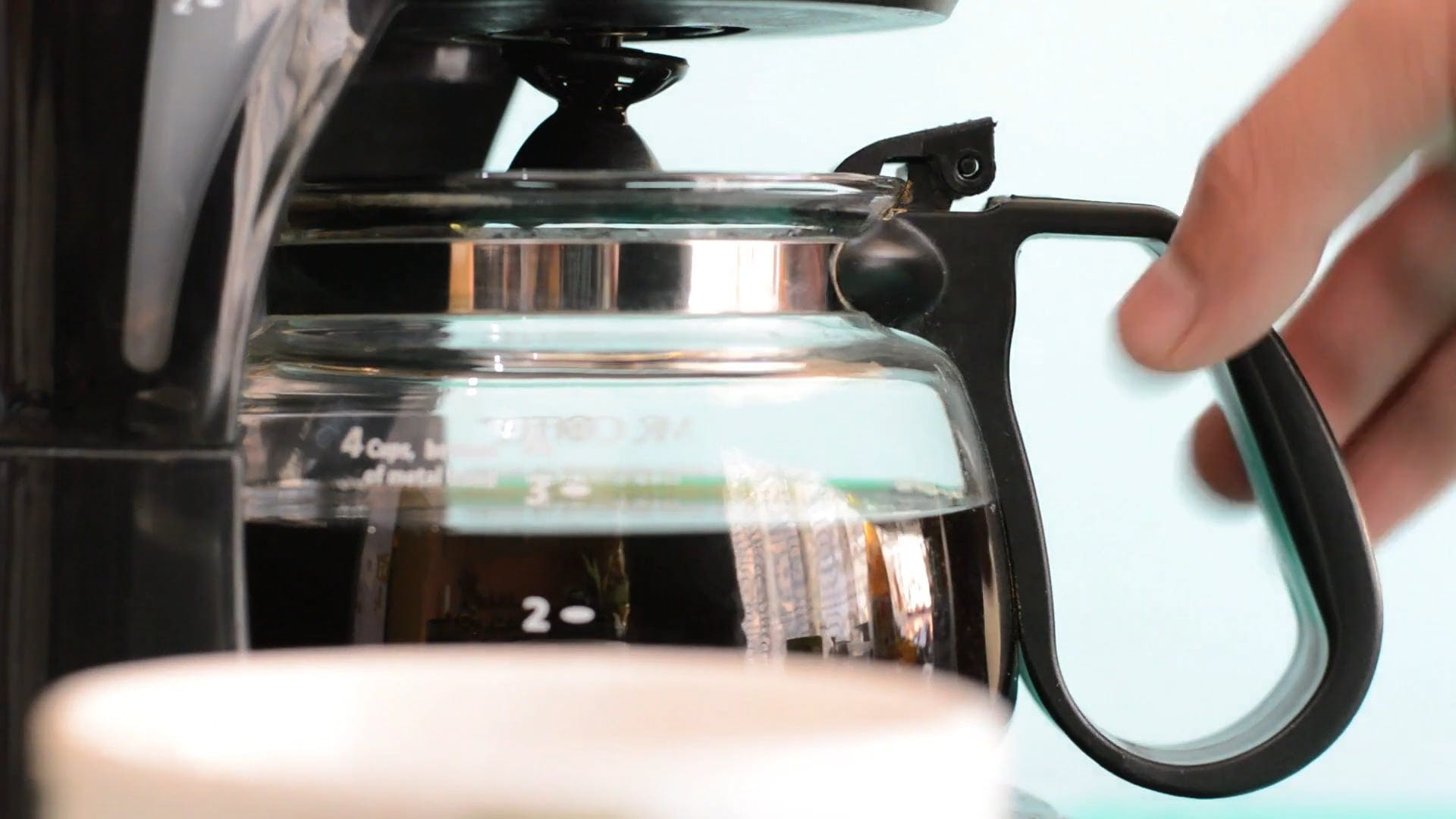 Pouring Coffee On Cup
