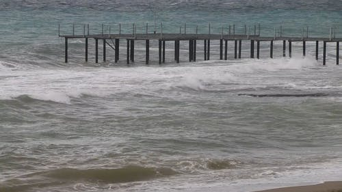 Strong Waves Hitting The Dock