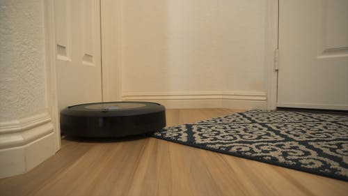 A Robot Vacuum Cleaner Cleaning the Floor