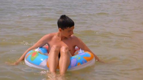 Boy On Floaters