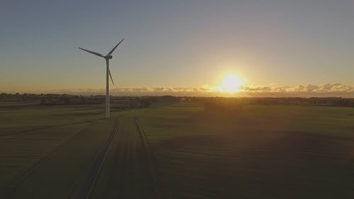 Wind Turbine on a Field at Sunrise