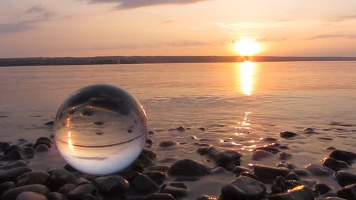 Glass Ball By The Shore