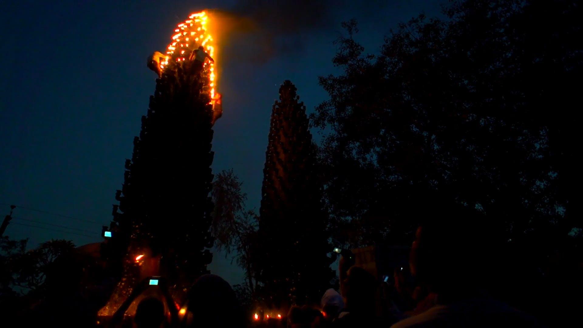 Men Lighting a Pillar of Torches