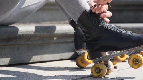 Man in Roller Blades Performing Infront of the People