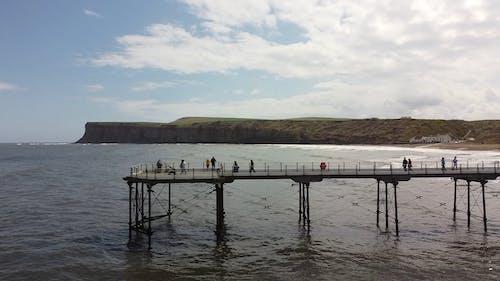 Drone Footage of People Walking on Pier