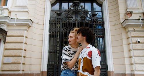 A Couple Posing outside a Building