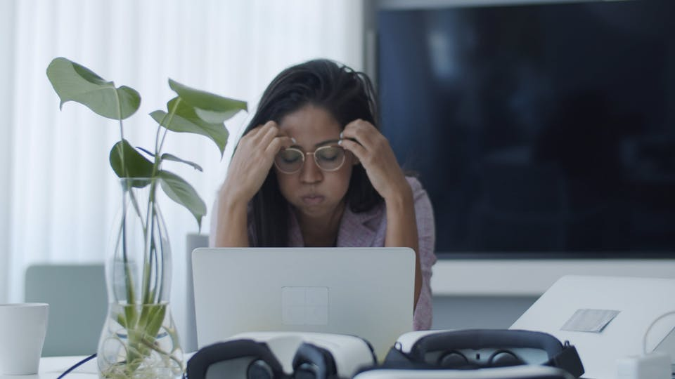 Frustrated Woman Using A Laptop