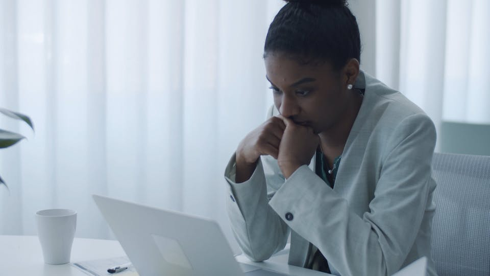 Woman Looking At The Screen Of A Laptop