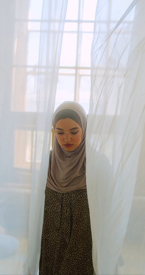 Woman Wearing Hijab Looking at Camera