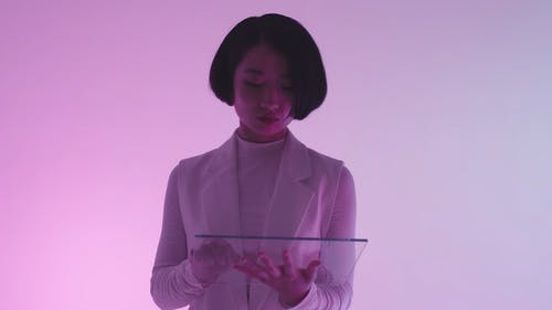 A Woman Using a Futuristic Tablet