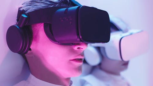 A Close up of a Man Talking while Using a VR Headset