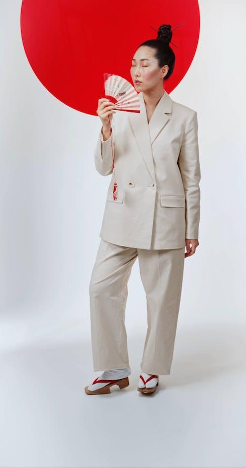 Woman holding Japanese Fan