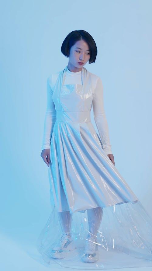 A Woman Wearing White Dress