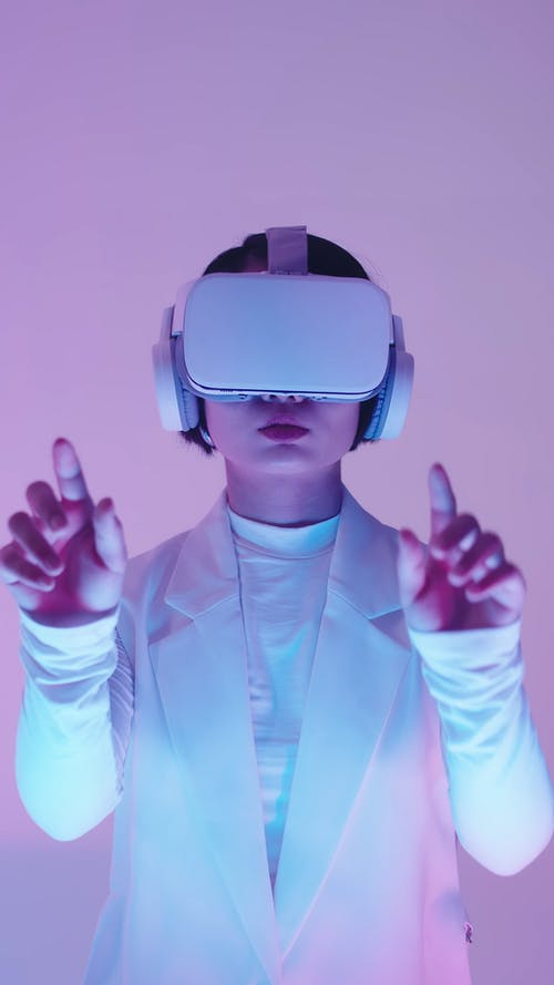 A Woman Wearing a VR Headset and Headphones