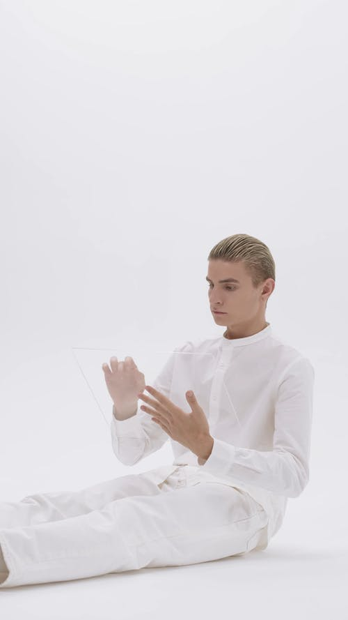 Man Typing on a Transparent Board
