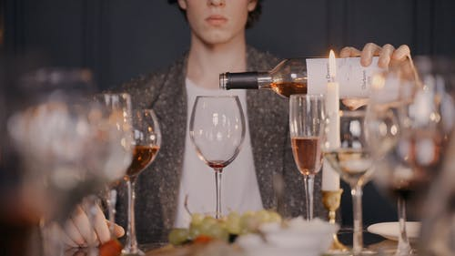A Man Pouring Wine in the Glass