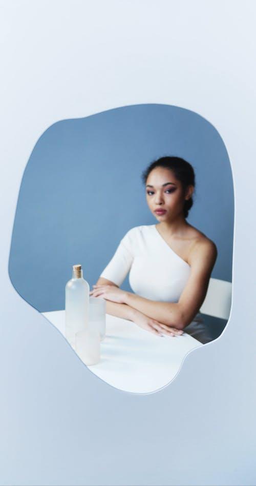Female Model Wearing a White Dress