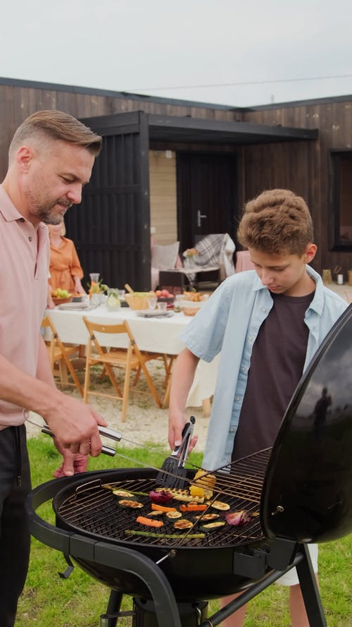 Father and Son Grilling Together