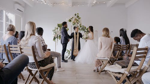 A Woman Pastor Officiating a Wedding