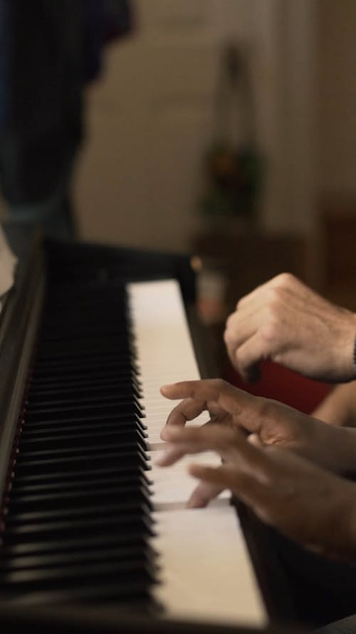 Close-up Footage of People Playing Piano