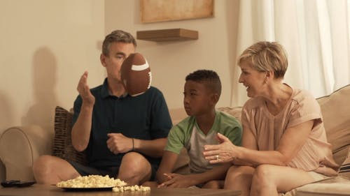 Family Watching a Football Game at Home