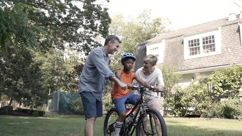 A Couple Teaching Their Son How to Ride a Bicycle