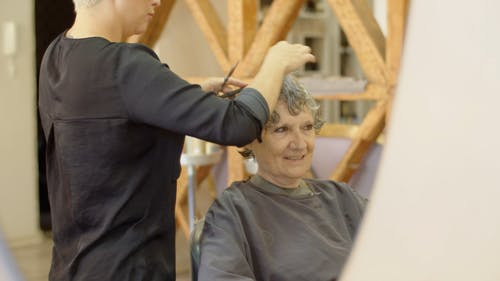 Hairdresser Cutting Clients Hair