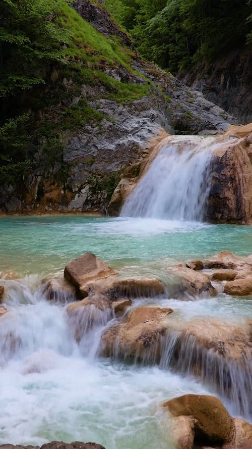 Small Waterfalls Flowing To River