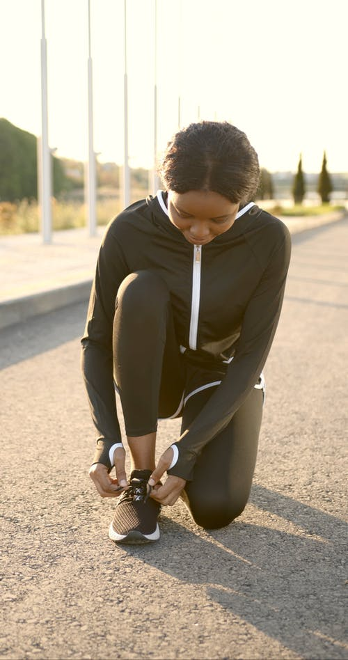 A Woman Tying Her Shoelaces