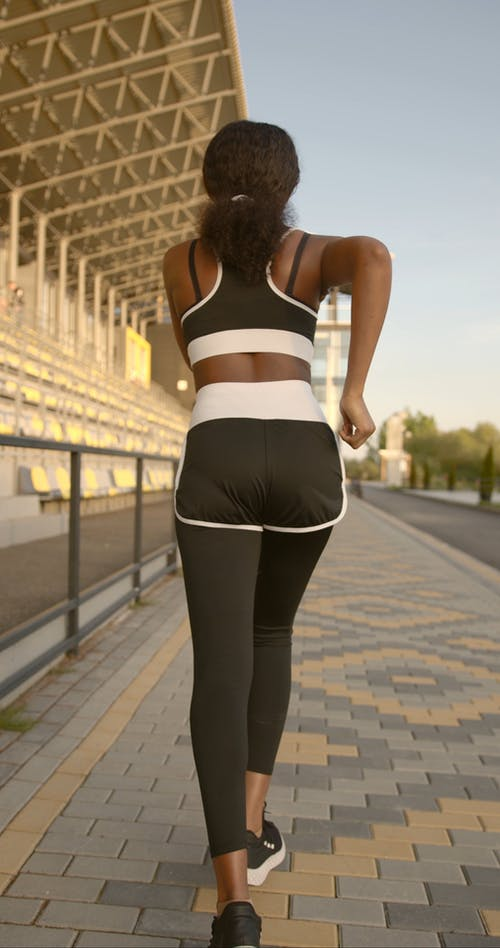 A Back View of a Woman Jogging