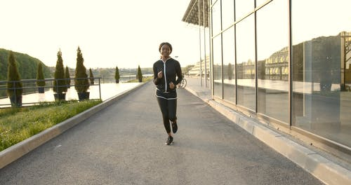 A Woman Smiling and Jogging