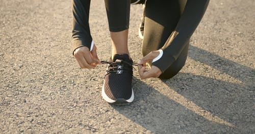 A Person Tying Their Shoelaces