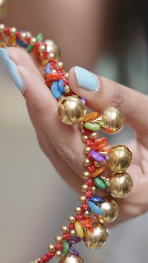 Close-up Footage of a Person Holding an Accessories